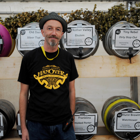 Volunteer Jamie Sellers in front of the barrels. Photograph taken by Simon Dack